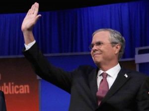 Jeb, seen here either waving or high-fiving God.